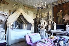 The 'winter bedroom', with statues of the Duke of Kent and Queen Victoria standing guard on either side of the TV. Photographed by Alexander James