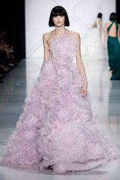 Lavender tulle ball gown embellished with 3D pleated silk organza and tulle flowers.