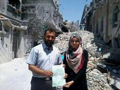 Proud father shows the graduation certificate of his daughter in front of their demolished house which was bombed in an Israeli raid. Despite the war, the 7-year siege of Gaza, intermittent electricity and water, Palestinians continue to study and succeed. Source: Tareq Al Farra via Twitter (Aug. 2014).
