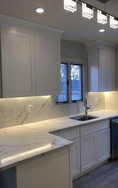 "Fabuwood white shaker cabinetry with MSI ""Calacatta Laza"" quartz countertops and full height backsplashes. Condo Kitchen, Home Decor Kitchen, Kitchen Interior, Home Kitchens, Kitchen Remodel, Countertop Backsplash, Quartz Kitchen Countertops, Granite, White Shaker Cabinets"