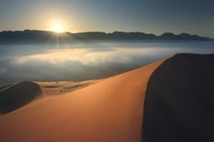"""""""Taken from a huge dune in a desert close to my city ( Sharjah, Oman ). The most difficult thing was how to attempt this point where the area was surrounded by heavy fog. """""""