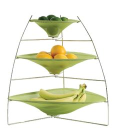 Chilewich Tree Tier Ray Tray  Modern in material and form, each basket is made of yarn mesh and secured over a metal frame. A gorgeous antidote to the common fruit bowl.