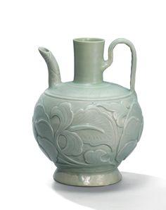 A carved celadon Yaozhou 'lotus' ewer, Five dynasties (907-960)