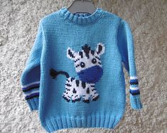 Kids sweater sleeves long Zebra hand knitted cotton machine washable at Size 18 months to 6 years Delivery costs offered for France Baby Boy Knitting Patterns, Baby Sweater Patterns, Baby Cardigan Knitting Pattern, Knit Baby Sweaters, Knitted Baby Clothes, Knitting For Kids, Girls Sweaters, Baby Patterns, Hand Knitting