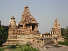 Lakshmana Temple at Khajuraho, a panchayatana temple. Two of the four secondary shrines can be seen. This temple is situated in the Western Group of temples. Khajuraho, Madhya Pradesh, India