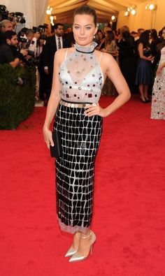 Pin for Later: Who Wore What: See Every Look on the Met Gala Red Carpet Margot Robbie at the 2014 Met Gala Margot Robbie embraced embellishment in Prada's custom powder blue silk organza tea-length dress.