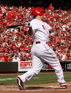 Cincinnati Reds' Joey Votto hits a single off Miami Marlins pitcher Mark Buehrle during the first inning of the Reds Opening Day baseball game, Thursday, April 5, 2012, in Cincinnati. Photo: David Kohl / AP