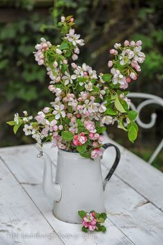 cottage flowers in enamel coffee pot...