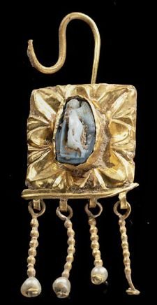 A Roman gold earring with a cameo made of a layered agate showing eros with a torch, 3rd century A.D.