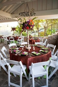 don't like the white chairs...I don't want anything white really, but love the green/copper and tall centerpiece