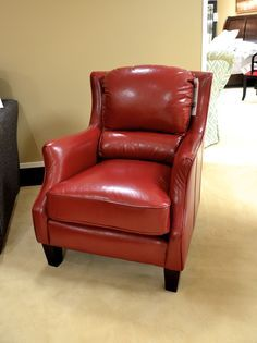 Russet brown leather recliner with baseball stitching and