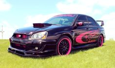 My Pink and Black Subaru <3 Impreza.  2004