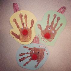 Super cute reindeer handprint Christmas ornaments.