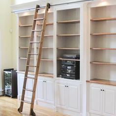 Quiet Glide 9 Ft Red Oak Standard Rolling Ladder with Rail Kit Rail Finish: Bronze, Rail Length: 12 Ft, Mounting Bracket Style: Horizontal Library Ladder, Library Wall, Closet Library, Library Shelves, Home Depot, Bookshelves Built In, Floor To Ceiling Bookshelves, Bookcase With Ladder, Bookcases