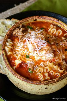 Lasagna Soup with cheesy yum from afarmgirlsdabbles. - This Lasagna Soup is truly like lasagna in a bowl. It's packed with the familiar flavors of lasagna, with an ooey gooey cheesy concoction that Crock Pot Recipes, Cooker Recipes, Hearty Soup Recipes, Easy Recipes, Amazing Recipes, Comfort Food Recipes, Italian Soup Recipes, Aloo Recipes, Best Soup Recipes