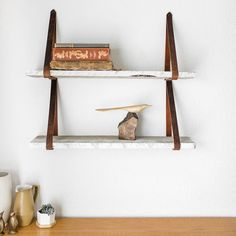Home decor items made from reclaimed Wyoming snow fence wood. Hanging shelves with leather straps, mountain shelves, and wine racks.