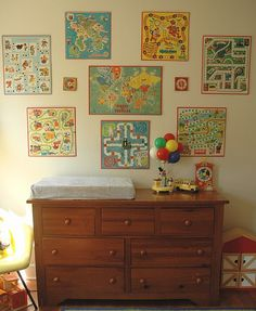 Wall of Games: I decorated our recreation room around our pool table with old board games. I am saving the pieces of the games to do other craft projects with.