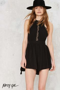 This romper from Nasty Gal features a sexy halter design, lace insert and detail, and open back. Fully lined, back zip closure. Perfect for that next festival you plan on attending, or a date night out with your boo.