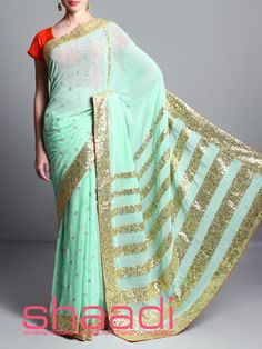 Light green georgette saree with sequined border and orange blouse Latest Indian Saree, Indian Sarees, Net Saree, Georgette Sarees, Orange Blouse, Green Saree, Indian Attire, Wedding Attire, Shades Of Green