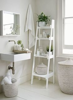 Go with an all-white decorating scheme to make your bathroom feel more spacious. A slim tapering ladder shelf unit, like this from The White Company, provides essential storage. Decorate the bathroom with potted plants and bud vases to add a natural touch Bad Inspiration, Bathroom Inspiration, Interior Inspiration, Bathroom Inspo, Bathroom Ideas Uk, Bathrooms Decor, Ideas For Small Bathrooms, Decorating Small Bathrooms, French Country Bathroom Ideas