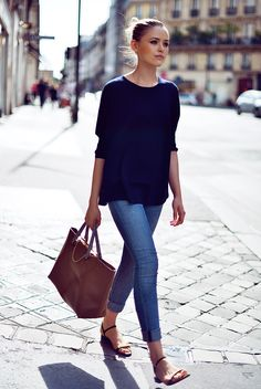 navy top, skinny jeans, flat sandals -- effortless street style