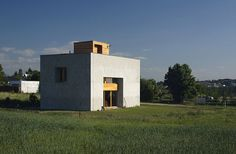 a modestly designed family residence frames each of the surrounding views near the small town of melnik.