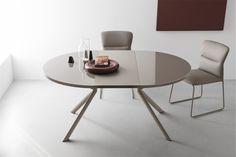 Tavolo allungabile rotondo in stile LUIS GUERIDON | Tables & Chairs ...