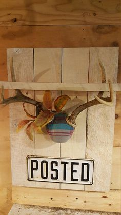 Rustic looking shelf with whitetail deer antlers and vintage