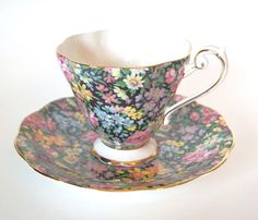 Vintage Teacup Black Floral Chintz Royal Standard Bone China Tea cup and Saucer Set with Daffodils and Pink Roses England by HouseofLucien on Etsy https://www.etsy.com/listing/227242525/vintage-teacup-black-floral-chintz-royal