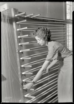 """November 1933. Gatlinburg, Tennessee. """"Beulah Ogle preparing warp for weaving at the Pi Beta Phi School. She is a new weaver at the school and lives on a mountain farm."""" Another example of Lewis Hine's post-newsie oeuvre. Large format nitrate negative, National Archives."""