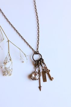 Favorite things Bella Vintaj Necklace. Key, Arrow, Crystal and Love Tag make for the most lovable and adorable necklace. All of the charms are interchangeable and moveable! Personalize this ethical necklace made in the USA.