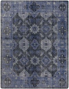 Hand knotted of wool and cotton, this stunning rug in washed navy, slate and cobalt with iris motif will create a dramatic focal point within any living space. (Pazar PZR-6000)