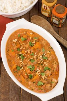 This is a simple version of a classic West African peanut stew made with boneless chicken thighs, sautéed ginger and garlic, tomatoes, sweet potato, peanut butter and fresh cilantro. Peanut Recipes, Crockpot Recipes, Soup Recipes, Chicken Recipes, Cooking Recipes, Recipe Chicken, Recipies, Chicken Feed, Chicken Bacon