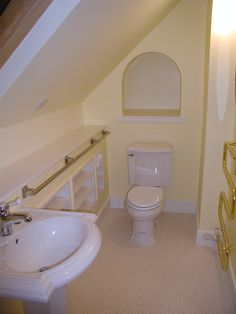 attic bathroom, hate the gold/brass  accents, but great way to incorporate sloped ceilings into bathroom when we finally finish in the attic