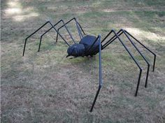 Make this easy DIY Spider for your Halloween yard display. It's made of PVC pipe, chicken wire and landscape fabric. Click through for the full tutorial.