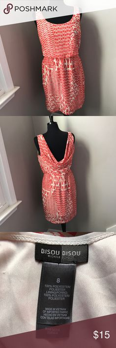 Orange and Cream Bisou Bisou Dress Beautiful sleeveless dress by Bisou Bisou is a size 8 and fully lined. This dress has a draped back and elastic at the waist. This dark orange and cream dress is in perfect condition and from a non smoking home. Bisou Bisou Dresses