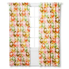 Curtains covered in brightly colored flowers.