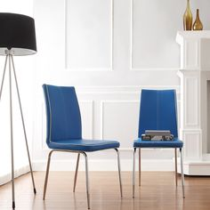 These vinyl chairs exhibit contemporary design with contrast trim and minimalistic form. Simple chrome legs finish these modern chairs.