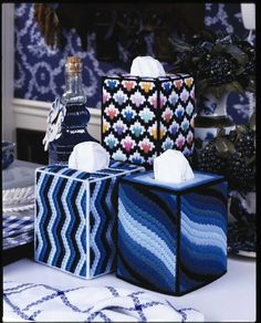 Top-Notch Tissue Box Covers - Look what you can make! This collection of tissue box covers in 7- and 10-mesh plastic canvas offers styles to fit any room or mood. Stitch a mix of fruits and vegetables for the kitchen. Spread Christmas cheer with a jolly Santa. Send a spinnaker sailing out to sea! You can create colorful pinwheels, bright bargello, 1940s flamingos--14 fanciful designs in all by Conn Baker Gibney. They're great for gifts or to use in your own home-sweet-home!