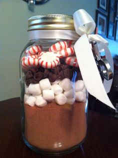 Christmas Cocoa {a DIY gift} Place 2 cups   of hot chocolate mix in the bottom of the mason jar.Layer 1 cup marshmallows,   1/2 cup chocolate chips and 20 starlight mints.Close the jar and attach recipe   card (and Christmas ornament if using) with ribbon.