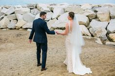 When your wedding couple breaks the rules and climbs upon a rock harbor for some amazing portraits!