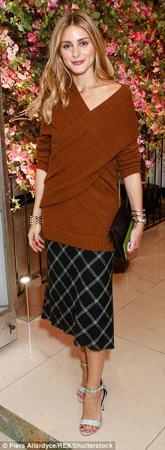 Style star: Style maven Olivia Palermo sizzled at the event in a burnt orange oversized jumper layered over her black and white check skirt