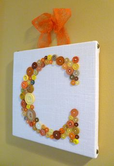 """Vintage Button Letter Art in Fall Colors Gold, Pumpkin Orange, Peach and Persimmon on 10""""x10"""" Canvas. $60.00, via Etsy."""
