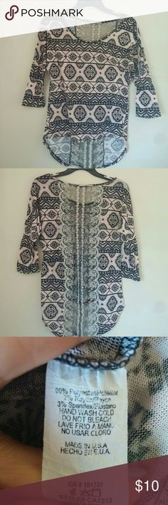 Charlotte Russe top Worn only once in perfect condition. Has lace centered back, 3/4 sleeves with funky design pattern from smoke free and pet free home. Charlotte Russe Tops