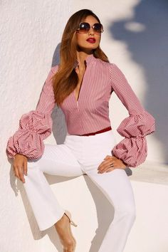 With its sexy plunging neckline, elasticized puff sleeves and shaping seams, our red and white striped shirt is ready to pair with crisp white bottoms and your favorite denim Blouse Styles, Blouse Designs, Chic Outfits, Fashion Outfits, Vetement Fashion, Look Fashion, Fashion Design, African Fashion Dresses, Trendy Tops