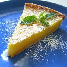 """Tart Lemon Triangles I """"So lemony and delicious! I thought the crust was going to be dry because it was before baking, but it came out perfect!!"""""""