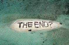"In this image released by Spectral Q, people form the phrase ""THE END?"" on an island at the barrier reef off the coast of Belize City, Belize, Saturday Nov. 13, 2010. The demonstration was held on the final day of the Belize Reef Summit which urged global leaders to take strong action for the environment at the upcoming U.N. Climate Change Conference in Cancun, Mexico."