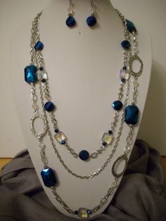 Irridescent Blue Crystals, Irridescent Clear Square Crystals, Silver Beads with Large Oval Silver Connectors Necklace and Earrings