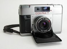 Contax T (1984) – Designed by Porsche, Carl Zeiss and Yashica in 1984 the Contax T is a camera of outstanding pedigree. Flexible metering, external flash for increased power and less red-eye, tack-sharp Zeiss lens and unlike the Minox 35 and Rollei 35 ranges you don't have to guess at focusing. Palm size and metal clad. #Photography #AnalogCamera #35mmFilm