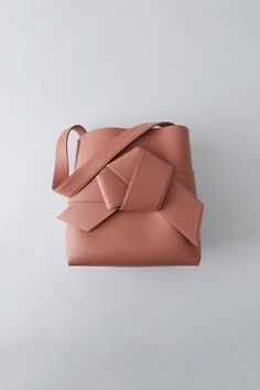 228c75b9ebdb Acne Studios Musubi Shopping pink is a large shopper based on the knot in a  traditional